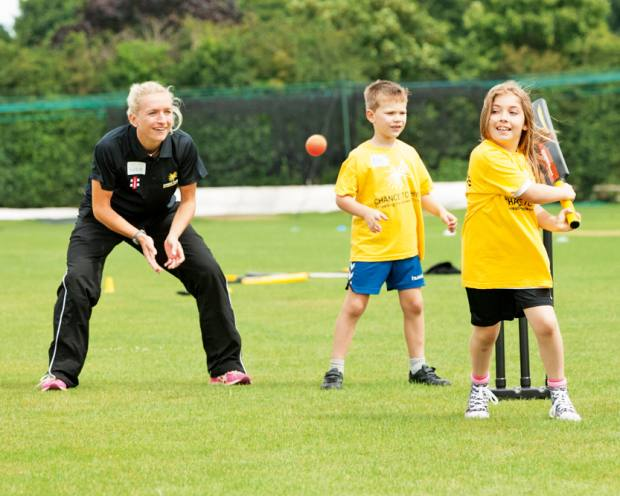 Cricketer Susie Rowe coaching children at a Chance to Shine summer camp