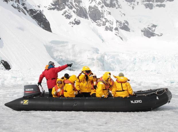 A Zodiac inflatable helps travellers get through the ice and closer to the shore