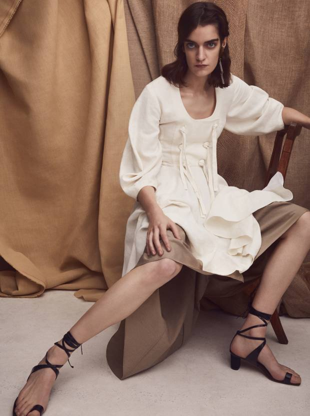 JW Anderson linen dress, £825. Brunello Cucinelli cotton skirt, £910. Céline leather sandals, about £500. Slim Barrett gold plated silver and glass earring, £680 for pair