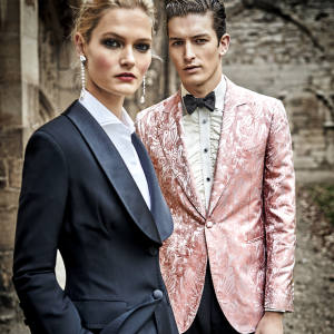 She wears Ermanno Scervino stretch-viscose jacket, £1,530, and matching trousers, £630. Brunello Cucinelli beaded stretch-cotton shirt, £620. Miu Miu crystal and pearl earrings, £895, from Browns. He wears Gieves & Hawkes silk jacket, £1,895, wool/mohair trousers, £250, and Barathea silk bow tie, £45. Turnbull & Asser silk shirt, £425