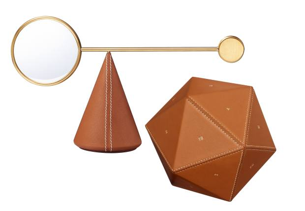 Equilibre d'Hermès gold-plated brass magnifying glass and leather cone, £1,240, and leather Icosahedron paperweight, £3,670