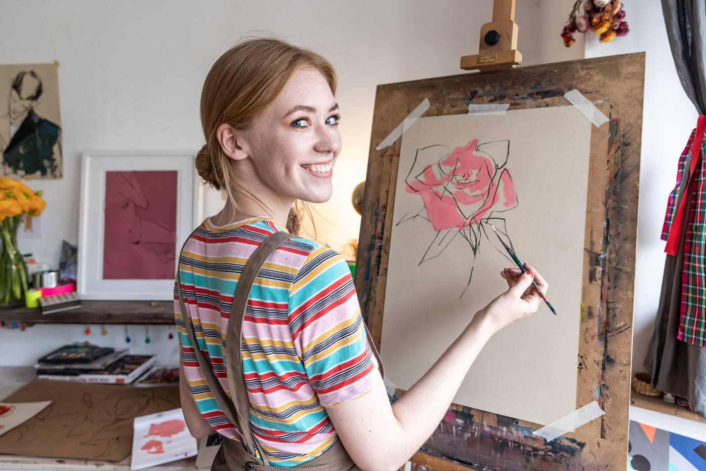 Jessica Bird in her studio with her rose illustration