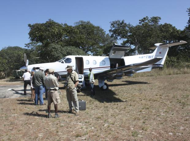 The author's expedition group prepares to board a Pilatus plane at Chief Chitambo's village at Ilala
