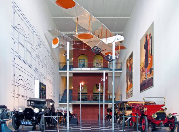 The Spyker collection in Spijker Hall, with (clockwise from front left) 1922 Spyker C4 All-Weather Coupé, 1911 Spyker 18HP Chassis, 1924 Spyker C4 Standard Torpedo Cabriolet, 1919 Spyker C1 13/30HP Torpedo Touring, 1912 Spyker 7HP Two-Seater, 1907 Spyker 15/22HP Three-Quarter Landaulette, 1907 Spyker 15/22HP Double Phaeton, 1906 Spyker 14/18HP Double Phaeton, and (centre top) 1913 Spyker Farman HF-20 plane