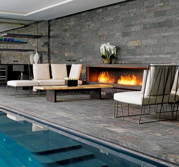 Rabih Hage added this Black Cohiba granite and Anthracite Sauvage stone fireplace, price on request, to a pool commission