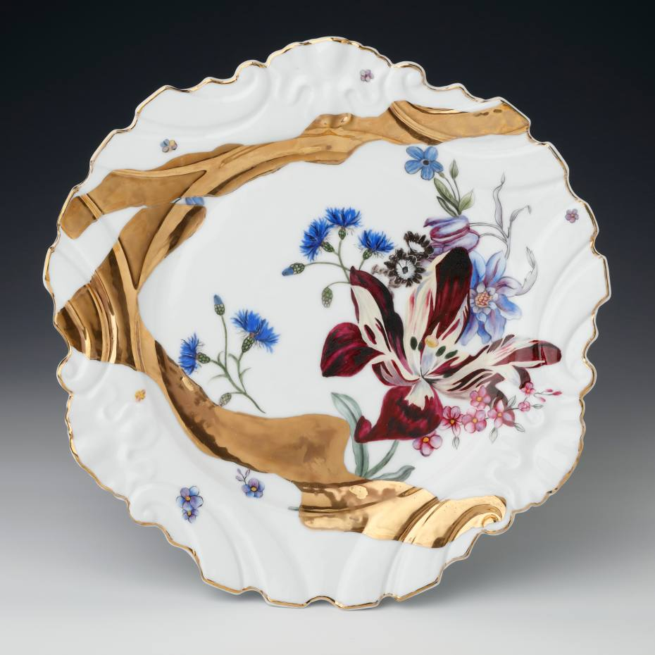 "The Alchemy dinner plate is adorned with sweeps of 24ct ""molten"" gold"