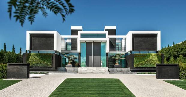 """Amansion beside the fourth hole of the San Lorenzo course at Quinta doLago, Portugal, has a 6m-high frontdoor, three pools and a cinema room, and is priced """"in the high-teen millions"""" through Quinta Properties"""