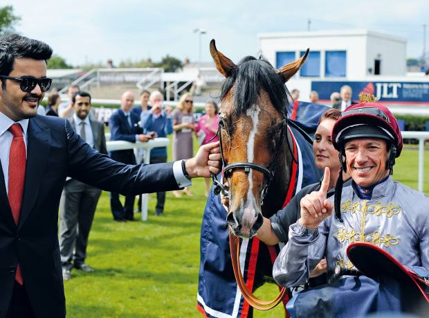 Sheikh Joaan with Frankie Dettori and Olympic Glory after winning the JLT Lockinge Stakes at Newbury in 2014
