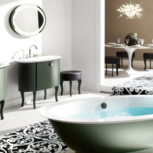 Burgbad's Diva glass-fronted cabinets, £4,015, mineral cast washstands, £5,860, mineral cast bath, £7,415, mirrors, £1,555, and leather stools, £1,155.