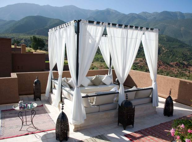 A rooftop terrace on the estate of L'Amandier, overlooking the Atlas Mountains