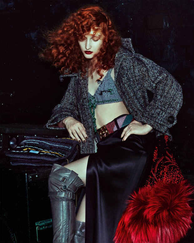 Prada embroidered tweed bouclé coat with fur trim,£5,075, wool knit bra, £475, satin skirt, £1,625, leatherboots, £1,780, lizard belt, £1,120, and wool knit pouchette, £1,290