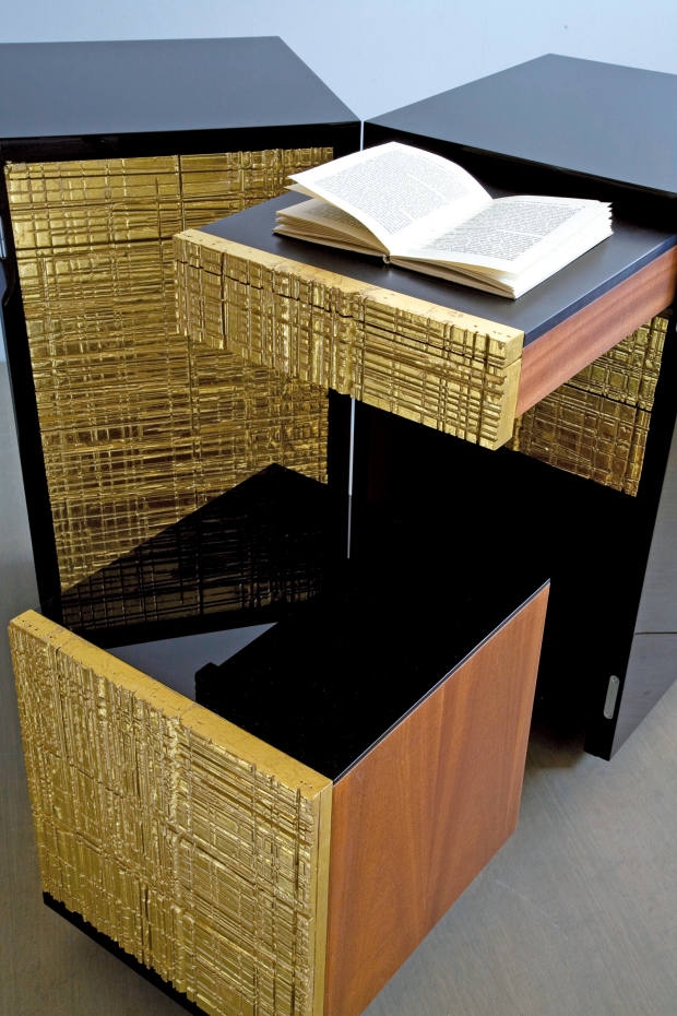 A stool and writing table within Paul Kelley's Black and Gold desk