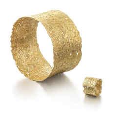 """Nina Bukvic gold """"lace"""" cuff, £23,900, and ring, £1,950"""