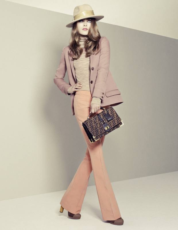 Wool jacket, £1,081, and silk and wool trousers, £965, both by Rochas from Liberty. Wool-and-silk-mix rollneck, £590, by Missoni. Felt trilby with python trim, £525, by Philip Treacy. Classico bag no 1 in Zucca monogram canvas, £910, and leather shoes, £635, all by Fendi. Fendi, 22 Sloane Street, London SW1 (020-7838 6288; www.fendi.com) and see Selfridges. Liberty, Great Marlborough Street, London W1 (020-7734 1234; www.liberty.co.uk). Missoni, 193 Sloane Street, London SW1 (020-7823 1910; www.missoni.com) and Selfridges. Philip Treacy, 1 Havelock Terrace, London SW8 (020-7738 8080; www.philiptreacy.co.uk) and stockists. Selfridges, 400 Oxford Street, London W1 (0800-123 400; www.selfridges.com). Hair: Christopher Sweeney at www.dwmanagement.co.uk using Kerastase. Make-up: Karina Constantine at Streeters using Dior Fall Look 2010. Make-up assistant: Natasha Hangyal. Model: Sophie Vlaming at Viva London. Stylist's assistants: Fabio Immediato and Milly Simon. Photographer's assistants: James Roebotham and Tristan Thompson. Digital technician: Joe Jackson. Set design: Andy Tomlinson. Casting: Paul Isaac.