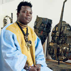 Romauld Hazoumé at London's October Gallery with his photographs Roulette Béninoise (left), 2004, and La Roulette, 2004, and the found objects installation Made in Porto-Novo.