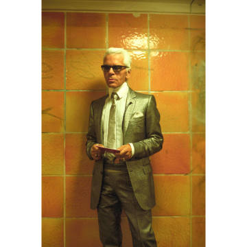 Lagerfeld paces the orange-tiled corridors of Rosenthaler Platz station