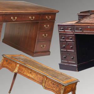 Left: Graham Hill's desk sold for £5,520. Right: Charles Dickens's desk sold for £433,250. Below: Lord Lucan's desk, £13,200.