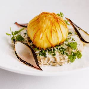 "A dish of ""risotto"" made from mushrooms, not rice, topped with an egg bound up in a tangle of potato ribbons and deep-fried at Kerridge's Bar and Grill"