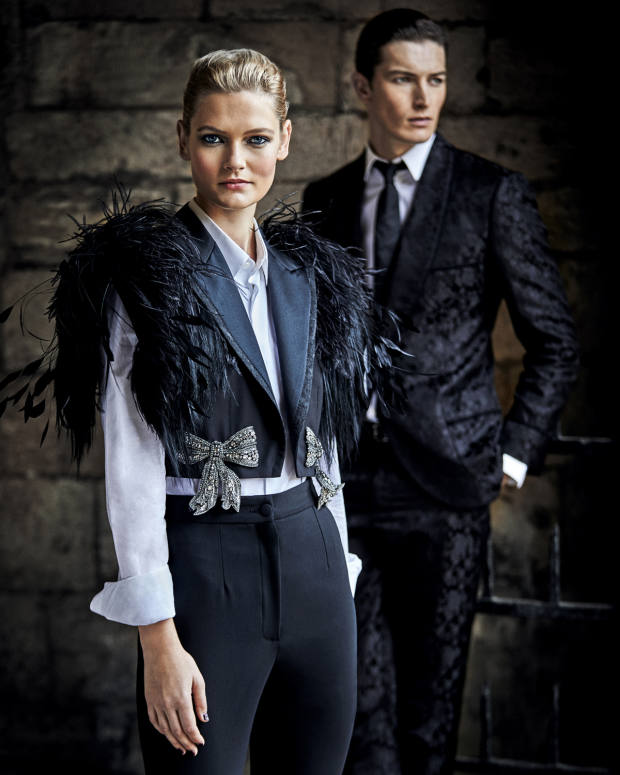 She wears Dolce & Gabbana wool and feather jacket, £3,488, cotton poplin shirt, £305, and wool trousers, £525. He wears Dolce & Gabbana wool/cotton jacket, £2,350, matching trousers, £745, cotton shirt with mother-of-pearl buttons, £425, and silk tie, £145