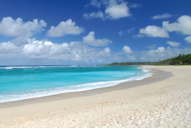 Three pristine beaches encircle the resort