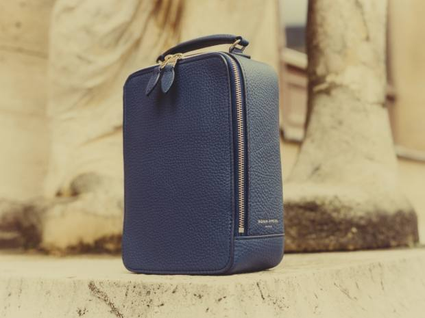 The interior of the bag has an inside-lid mirror and secret pockets