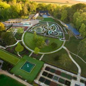 An aerial view of the grounds, which include a baroque maze, orchards and vegetable plots