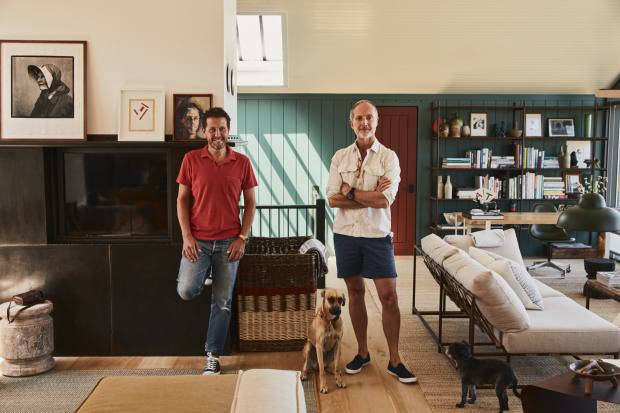 Konig, left, and Brown in the open-plan living and dining room, with daybeds by Stephen Kenn, and Sunny the dog