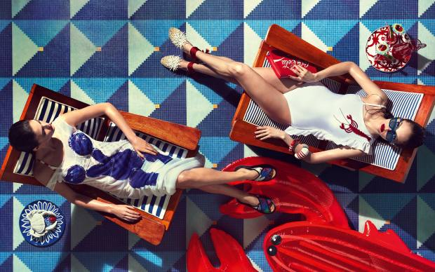 From far left: Charlotte wears Céline polyamide-mix dress, £2,200. Tommy x Gigi polyester swimsuit (just seen), £110. Boss lace and leather sandals, £415. Auguste wears Adriana Degreas Lycra swimsuit, £385. Aquazzura canvas and PVC flats, £725. Céline sunglasses, £239. Furla large resin bangle, £90, and small resin bangle, £70. Pinko calfskin bag, £151. Antique armchairs upholstered with Dedar polyester-mix Tricot Rayure/Baguette fabrics, £136 per m. Hermès china plates, £251, from Harrods. Oscar de la Renta earthenware crab condiment server, about £135. Moser for David Linley crystal jug, £350, and glasses, £95 each. Talking Tables cocktail umbrellas, £10.99 per pack. SunnyLife lobster float, £50, from Shopbop. Bisazza by Alessandro Mendini glass Ferrara Oro Giallo tiles, about £1,140 per sq m