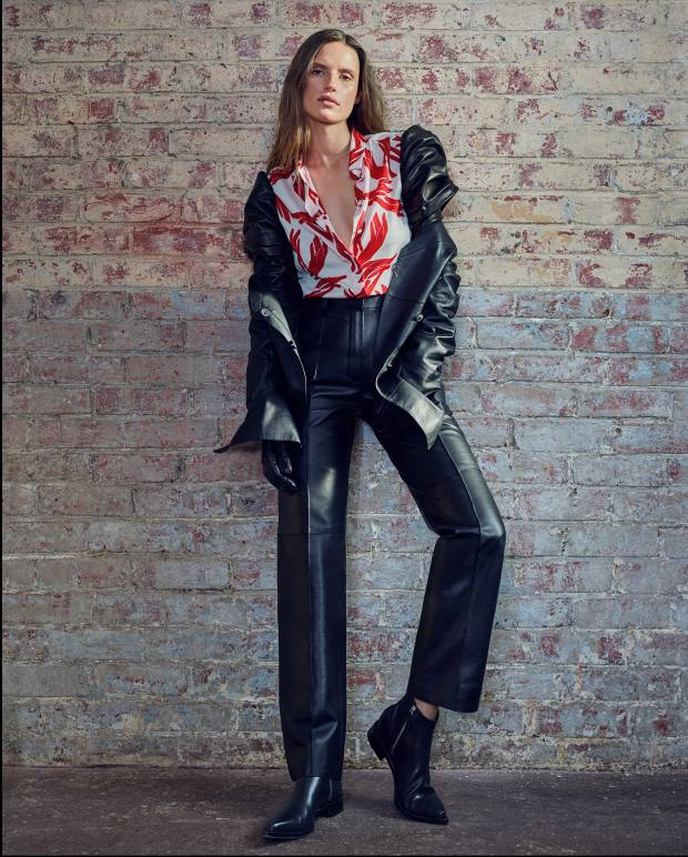 Hermès water-repellent calfskin jacket, £5,140, matching trousers, £4,390, and silk crepe Les Mains shirt, £1,780. Alexander McQueen leather ankle boots, £890. Paula Rowan lambskin Lola gloves, about £1,555