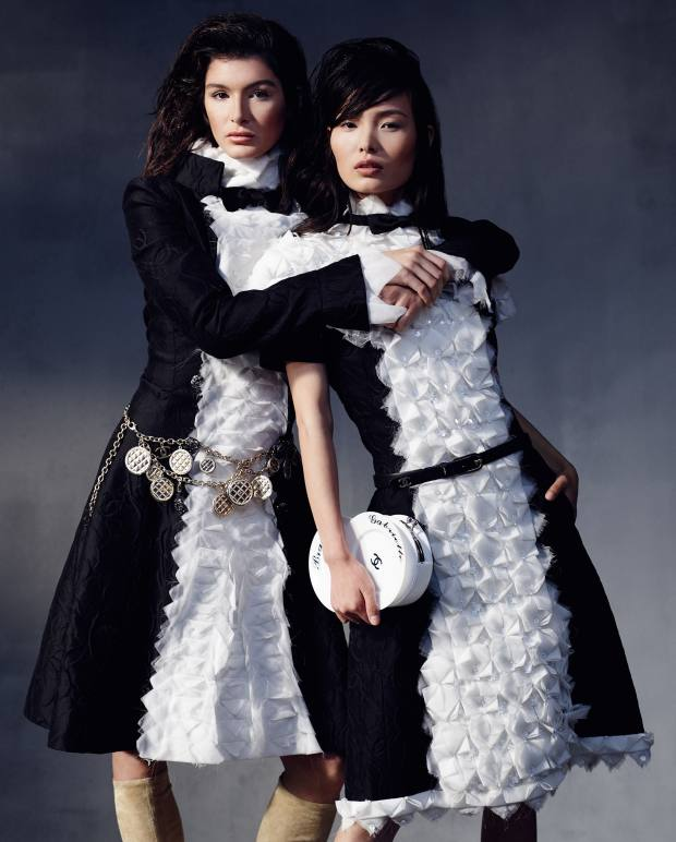 From far left: Bella wears Chanel cotton/silk jacquard dress, about £11,720, gold plated medallion belt, about £2,000, and lambskin suede boots, about £810. Ling wears Chanel cotton/silk jacquard dress, about £17,450, calfskin belt, about £385, and lambskin and Plexiglas clutch, about £5,775   Make-up used throughout Chanel Le Volume Ultra Noir mascara and Le Lift