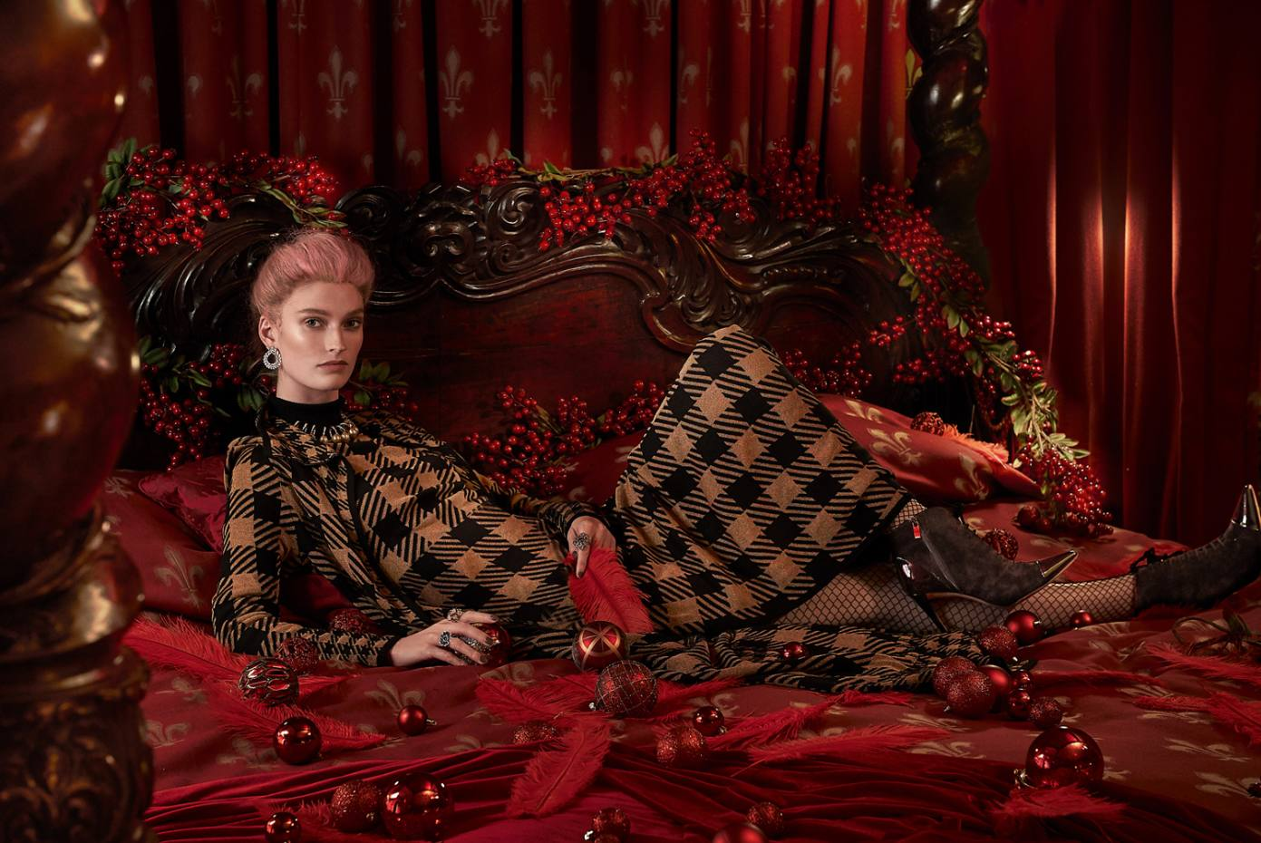Temperley wool Trophy cardigan, £795, and matching dress, £795. UK Tights Fiore Myrna fishnet tights, £6.99. Gina suede and patent leather boots, £695. Chopard white gold and diamond Laurel earrings, white gold, diamond, South Sea pearl, ruby, blue sapphire, pink sapphire, amethyst and tourmaline necklace, (from left) white gold, diamond and sapphire ring, rose gold and diamond ring, and white gold ring, all price on request  VV Rouleaux berry garlands (seen throughout), £47 each. Christmas baubles, from £5.95, from Liberty. Small plain baubles, £29.99 for 100, from The Magic Toy Shop
