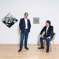 Matthew Ho (left) with Ben Brown at Brown's Hong Kong gallery. Works on the wall from left: Ophelia by Gerhard Richter. Kleine Malerische Handlung Kreis Kreise by Günther Uecker