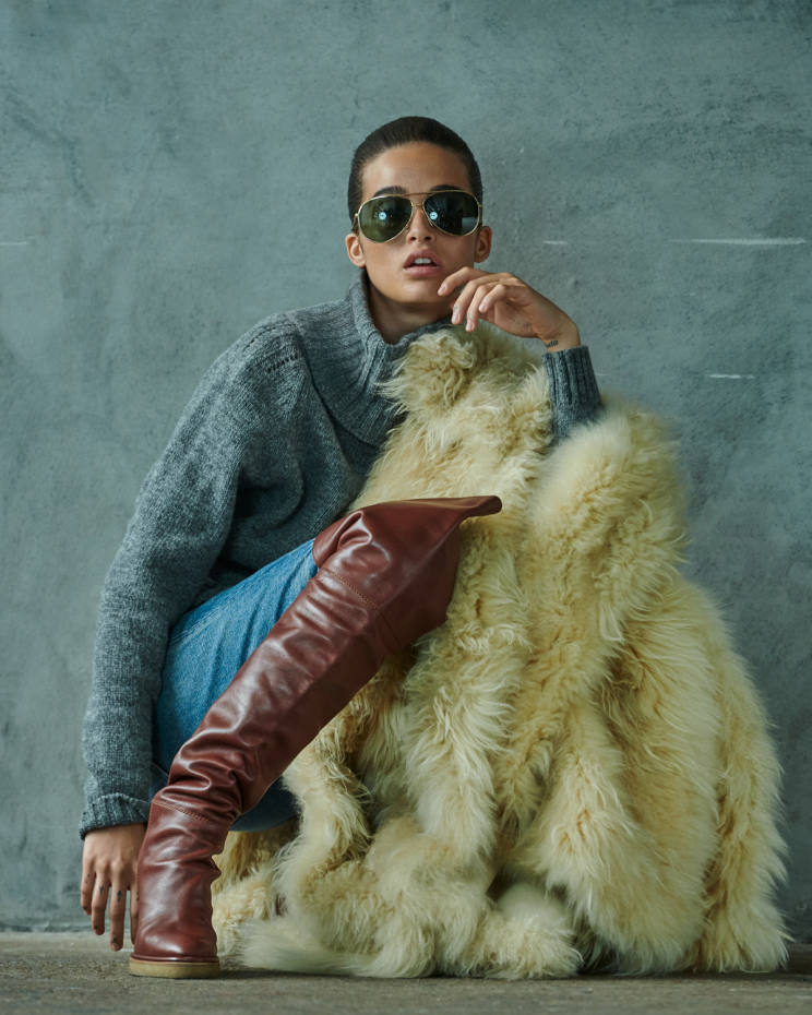 Celine by Hedi Slimane cashmere goat cape, POA, wool jumper, £470, cotton jeans, £590, metal calfskin boots, £1,400, and sunglasses, £320