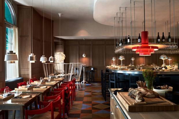Grand Hôtel's Ilse Crawford-designed Matbaren (dining bar) serves à la carte dishes at an open-kitchen counter