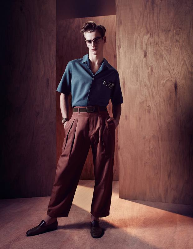 Christophe Lemaire cotton/linen shirt, £235, and cotton/linen trousers, £450. Bottega Veneta woven-leather slip-on shoes, £655. Garrett Leight acetate and metal Lincoln glasses, £250, from The Eye Company. Hardy Amies silk/cotton handkerchief, £25, and leather belt, £95. Emporio Armani stainless-steel Melting Gold watch with lizard strap, £795