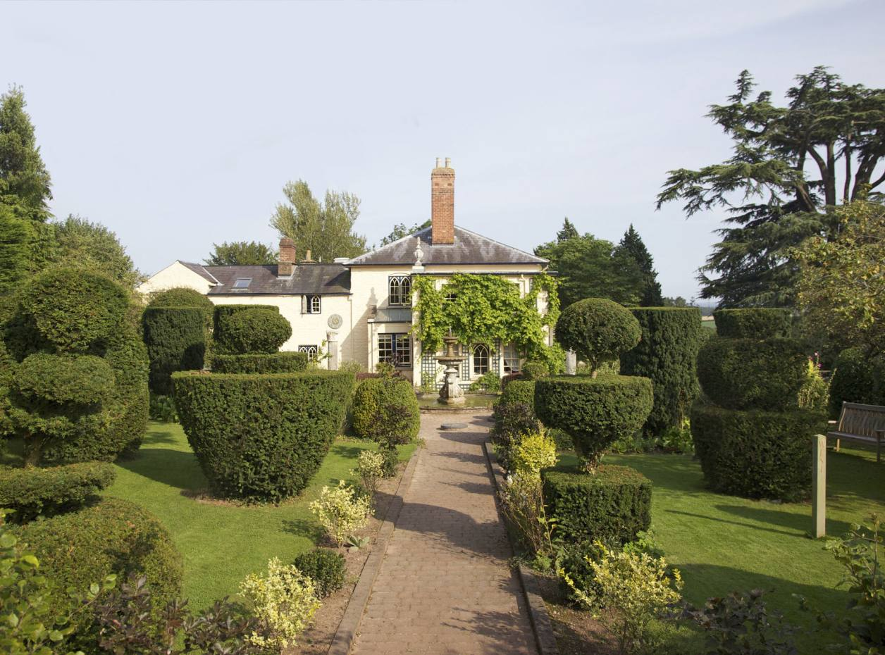 "At The Laskett in Herefordshire, Sir Roy Strong has used topiary to create a formal garden of discrete ""rooms"""