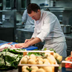 Chef Theo Randall at work in his kitchen