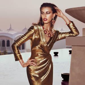 Saint Laurent by Hedi Slimane silk dress, £2,605. Amrapali gold, diamond, ruby and emerald lotus-flower necklace and earring set, £125,000, and gold, diamond and ruby bangles, £16,500 each