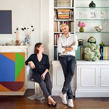 Simone Gooch with Oscar Humphries in his London home, with flowers by Gooch