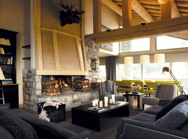 A huge picture window brightens the drawing room of Yellowstone Ski Lodge in Sainte Foy, France.
