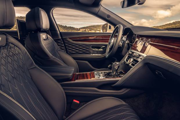 The car's interior is furnished with fluted leather seating