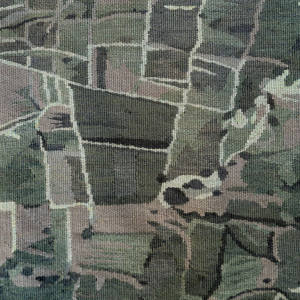 Small vegetable fields are plotted in unevenly dyed wool on this Vaska rug, €12,000, using a French flatweave technique
