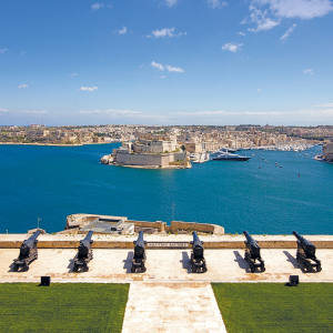 The Saluting Battery on Valletta's fortified walls, overlooking the Grand Harbour and Three Cities beyond