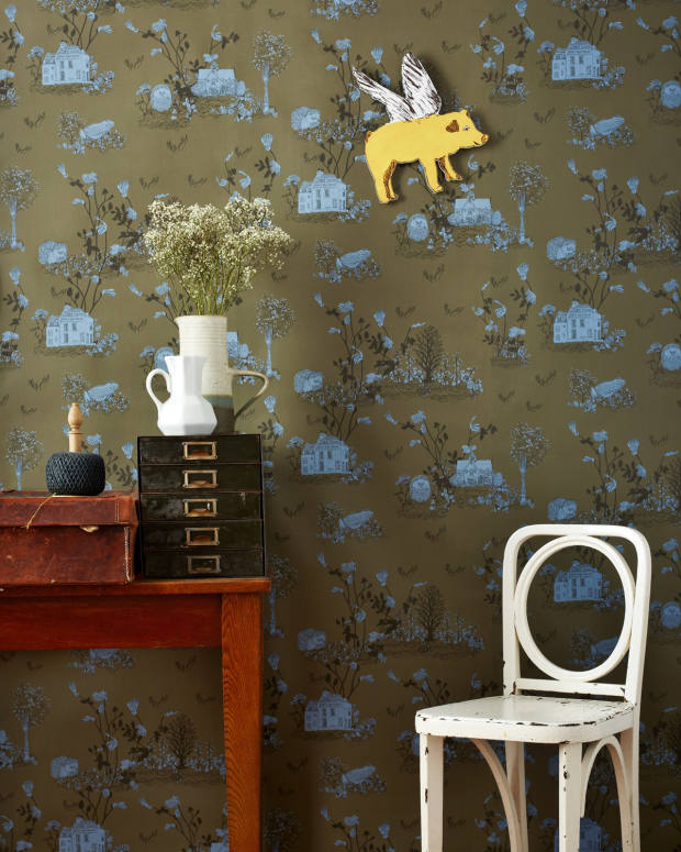 Sian Zeng khaki Woodlands wallpaper with flying-pig magnet, £264.50 a roll