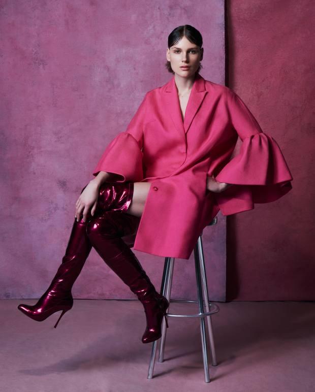Delpozo wool-mix coat, £1,536. Christian Louboutin PVC Classe Hot boots, £995