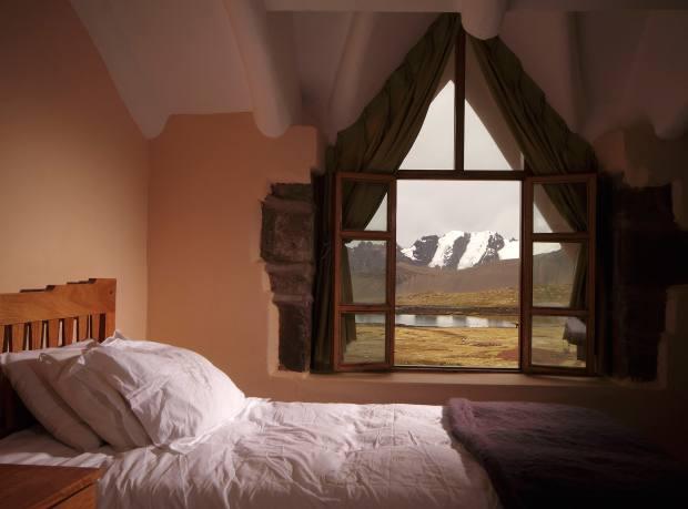 A bedroom at Huampococha Tambo Lodge, overlooking El Nevado del Inca