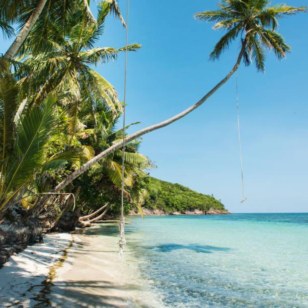 The pool deck atMonasterio del Viento hotelito overlooks the island of Crab Cay