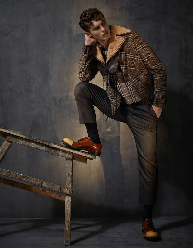Prada tweed, leather and shearling jacket, £3,160, wool top, £1,270, wool trousers, £710, cotton socks, £70, and leather shoes, £775