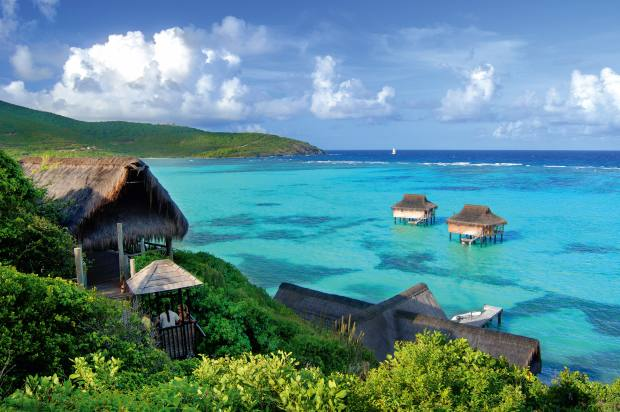 The spa at Pink Sands Clubin the Grenadines has treatment rooms on the water; from $7m for a three-bedroom cottage through Savills