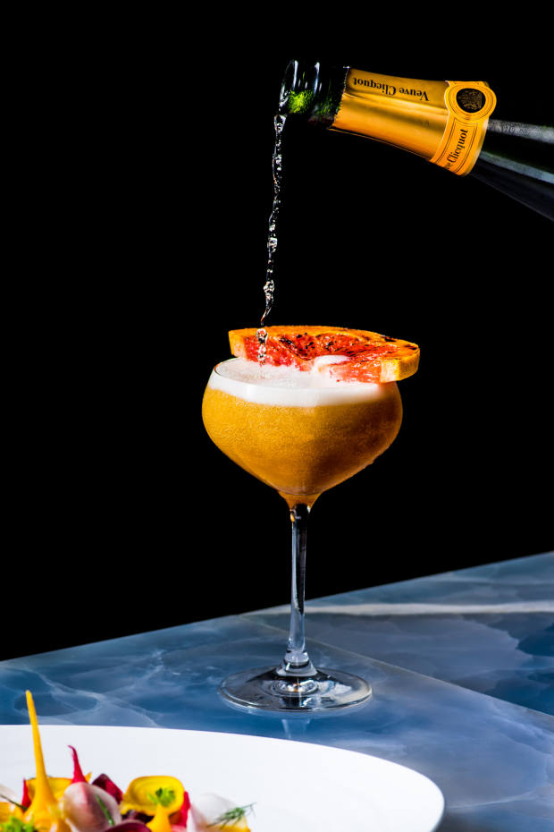 The Royal Mail, $19, is made with eight-year-old Bacardi rum, Veuve Clicquot champagne and Earl Grey tea and garnished with a bruléed grapefruit